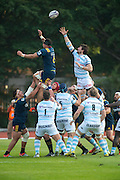 Highlanders player Elliot Dixon (L) challenges for the ball during the line-out with Racing 92 player Thibault Dubarry.Rugby union match The Highlanders vs French team Racing 92