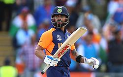 India's Virat Kohli celebrates reaching his half century during the ICC Cricket World Cup group stage match at Edgbaston, Birmingham.
