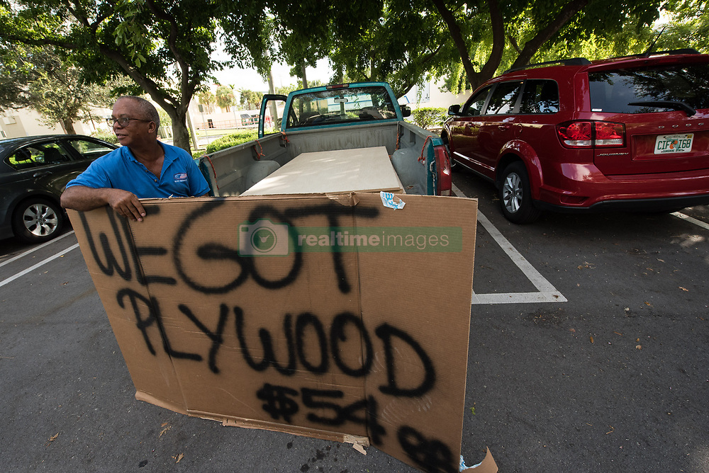 September 8, 2017 - Delray Beach, Florida, U.S. - A man tries to sell plywood from the back of his truck in a Home Depot parking lot before being asked to leave by employees.Hurricane Irma is expected to make landfall near South Florida by Sunday morning.  (Credit Image: © Ken Cedeno via ZUMA Wire)