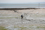A man rescuing his children from beach mud after the sea tide went off as the sun heatwave hits England on Wednesday, Jun 2, 2021. It was the third day this week that the record for the hottest temperature of 2021 has been broken British tabloids say. (Photo by Vudi Xhymshiti)