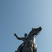 Looking up at a large statue of Venezuelan leader Simon Bolivar, by Felix de Weldon, that stands in a park in front of the Interior Department in Foggy Bottom in northwest Washington DC. The statue was installed as a gift of the Venezuelan Government in 1955 and is formally titled Equestrian of Simon Bolivar.