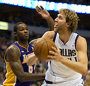 Dirk Nowitzki (41) of the Dallas Mavericks posts up against  Earl Clark (6) of the Los Angeles Lakers at the American Airlines Center in Dallas on Sunday, February 24, 2013. (Cooper Neill/The Dallas Morning News)
