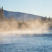 Morning fog on the Fishing Branch River near Bear Cave Mountain in the Yukon Territory, Canada.