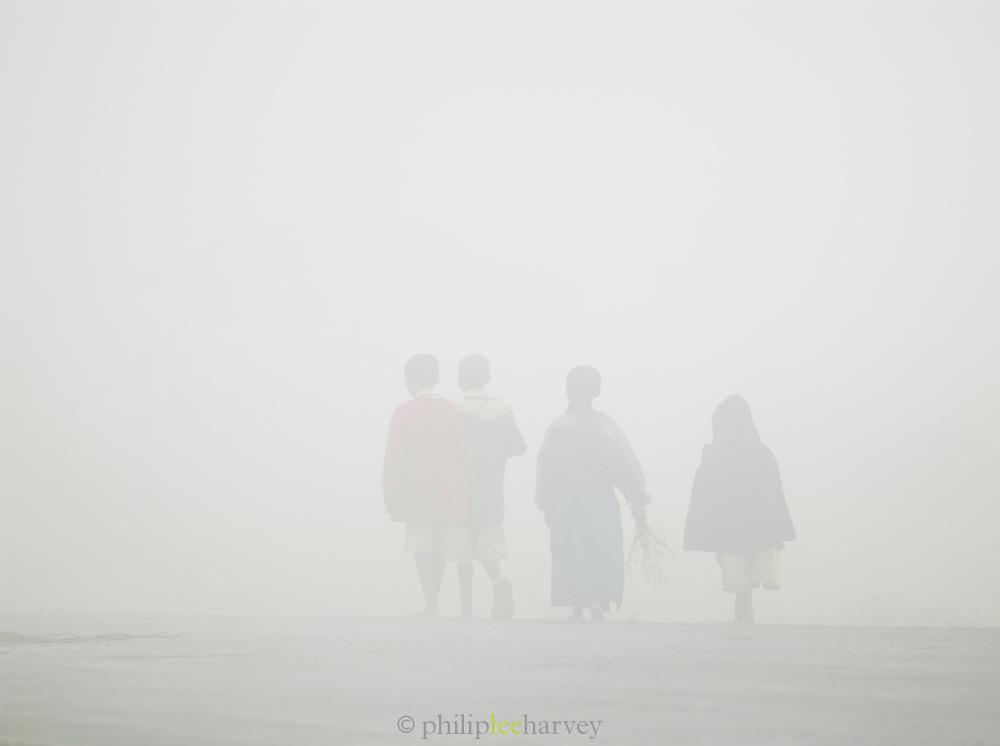Children walking in the mist near Kigali, Rwanda