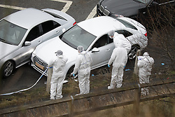 © Licensed to London News Pictures. 03/01/2017. Huddersfield, UK. Scene where a bullet riddled white Audi car at the slip road at Junction 24 of the M62 motorway in Huddersfield has been stopped . West Yorkshire police have announced a man has died following the discharge of a police firearm , during what they describe as a pre-planned operation , yesterday evening (2nd January 2017) . Photo credit : Joel Goodman/LNP