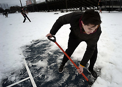 April 18, 2018 - St. Paul, Minnesota, USA - United States - Orion Knutson, a senior tennis team player at White Bear Lake High School shovels an open spot on the courts to help start the melting process. ''Not a fan,' says Knutson about the frigid weather and snow.]What will it take to get fields ready to play high school sports? More than just melting the snow, according to school officials, some of whom think it could be two weeks or more before they are thawed out and playable. Richard Tsong-Taatarii•rtsong-taatarii@startribune.com (Credit Image: © Richard Tsong-Taatarii/Minneapolis Star Tribune via ZUMA Wire)