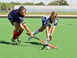 The captain of the Fanie Theron team, Pascal Canham and Robbie Dicey of the Gericke Champs team clash on the first day of the Super 5's junior tournament, held at the Hartleyvale stadium in Cape Town. The tournament ends on Saturday.