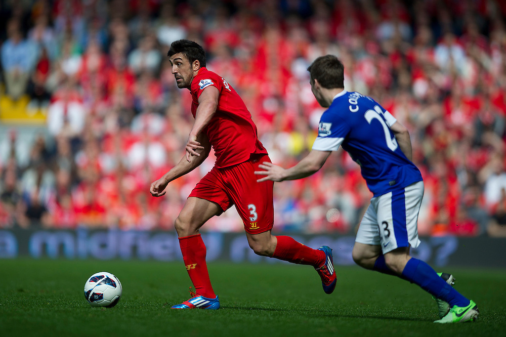 Liverpool's Jose Enrique gets away from Everton's Seamus Coleman .. - (Photo by Stephen White/CameraSport) - ..Football - Barclays Premiership - Liverpool v Everton - Sunday 5th May 2013 - Anfield - Liverpool..© CameraSport - 43 Linden Ave. Countesthorpe. Leicester. England. LE8 5PG - Tel: +44 (0) 116 277 4147 - admin@camerasport.com - www.camerasport.com