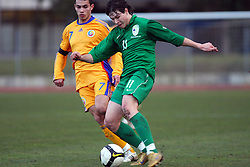 Catalin Iorga of Romania and Etien Velikonja (11)  of Slovenia during Friendly match between U-21 National teams of Slovenia and Romania, on February 11, 2009, in Nova Gorica, Slovenia. (Photo by Vid Ponikvar / Sportida)