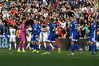 Football - 2019 / 2020 Sky Bet (EFL) Championship - Swansea City vs. Reading<br /> <br /> Swansea   celebrate in front of jubilant swansea fans  as Cardiff trudge off after winning the South Wales derby match , at the Liberty Stadium.<br /> <br /> COLORSPORT/WINSTON BYNORTH