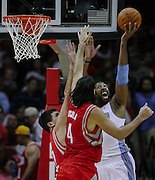 Oct 30, 2010; Houston, TX, USA; Denver Nuggets center Nene Hilario (31) lays a shot in over Houston Rockets power forward Luis Scola (4) during the third quarter at the Toyota Center. The Nuggets won 107-94. Mandatory Credit: Thomas Campbell-US PRESSWIRE
