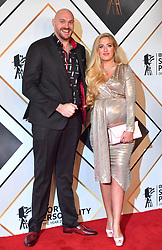 Tyson Fury and wife Paris during the red carpet arrivals for the BBC Sports Personality of the Year 2018 at The Vox at Resorts World Birmingham.