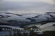 The view of Muirhouse farm, Stow village and the surrounding hills on 3rd of January 2021 in Stow, Scottish Borders, United Kingdom. Much of the Scottish Borders is farmland on rolling hills. The A7 runs throughStow and the valley to and from Edinburgh to the North.