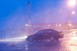 © Licensed to London News Pictures. 8/02/2016. Porthcawl, Bridgend, Wales, UK. Huge waves pound the seafront. Storm Imogen batters the small Welsh seaside resort of Porthcawl in the county borough of Bridgend on the South coast of Wales, UK. Photo credit: Graham M. Lawrence/LNP