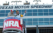 Texas Gov. Rick Perry get instructions for waving the green flag before the start of the Sprint Cup NRA 500 at Texas Motor Speedway in Fort Worth on Saturday, April 13, 2013. (Cooper Neill/The Dallas Morning News)