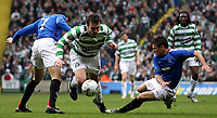 Photo: Paul Thomas.<br /> Glasgow Celtic v Glasgow Rangers. Bank of Scotland Scottish Premier League. 11/03/2007.<br /> <br /> Lee Naylor (C) of Celtic is fouled by Nacho Novo (R) and Barhim Hemdani (L).