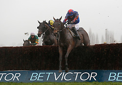 Splash Of Ginge and Tom Bellamy lead the field over the last fence before going on to win The BetVictor Gold Cup Handicap Steeple Chase Race run during day two of the November Meeting at Cheltenham Racecourse.