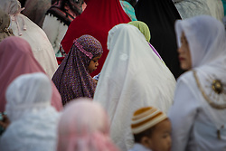 February 14, 2013 - Central Jakarta, Jakarta, Indonesia - Muslim womans during Eid Al-Fitr prayer on plastic grass at futsal stadium on June 15, 2018 in Jakarta, Indonesia. Muslims around the world are celebrating Eid al-Fitr, the three day festival marking the end of the Muslim holy month of Ramadan, it will be observed on 15th or 16th of June depending on the lunar calendar. Eid al-Fitr is one of the two major holidays in Islam. (Credit Image: © Afriadi Hikmal via ZUMA Wire)