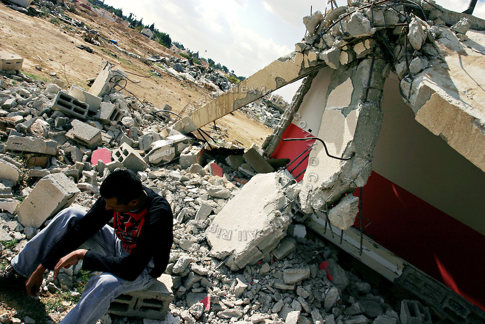 A Bedouin man is sitting by the rubble of a house put down by Israeli forces, on in the unrecognised Bedouin village of Tarrabin el Sana, close to BeerSheva, the capital of the Negev, a large deserted area in the south of Israel. The village, bordering the wealthy Israeli settlement of Omer, is surrounded by barbed wire and bound to be demolished as it is deemed illegal by the authorities, willing to further expand Omer's borders. Numbering around 200.000 in Israel, the Bedouins constitute the native ethnic group of these areas, they farm, grow wheat, olives and live in complete self sufficiency. Many of them were in these lands long before the Israeli State was created and their traditional lifestyle is now threatened by subtle Governmental policies. The seven Bedouin towns already built are all between the 10 more impoverished towns in Israel.