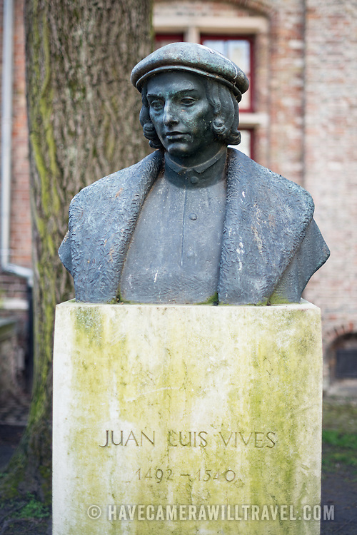 """A statue of Juan Luis Vives (1493 – 1540) in Bruges. He was a Valencian scholar and humanist who spent most of his entire adult life in the Southern Netherlands. His beliefs on the soul, insight to early medicine practice, and perspective on emotions, memory and learning earned him the title of the """"father"""" of modern psychology."""