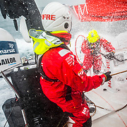Leg 9, from Newport to Cardiff, day 06 on board MAPFRE, speed record day. Blair looking at Xabi at the aft pedestal. 25 May, 2018.