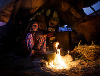 PUSHKAR, INDIA - CIRCA NOVEMBER 2016: Indian woman early morning preparing breakfast inside a tent during the Pushkar Camel Fair. It is one of the world's largest camel fairs. Apart from the buying and selling of livestock, it has become an important tourist attraction.