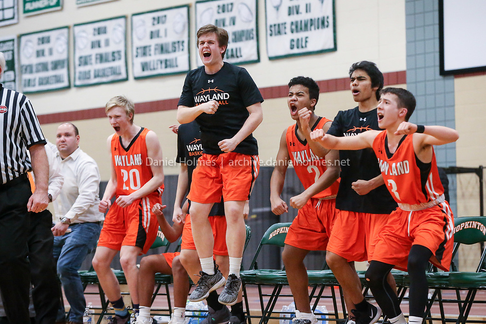(2/27/19, HOPKINTON, MA) The Wayland bench reacts as their lead is extended during the Div. 2 Central Quarterfinal boys basketball game against Hopkinton at Hopkinton High School on Wednesday. [Daily News and Wicked Local Photo/Dan Holmes]