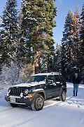 A man and his jeep on a snowy road in the Klamath Basin. MR