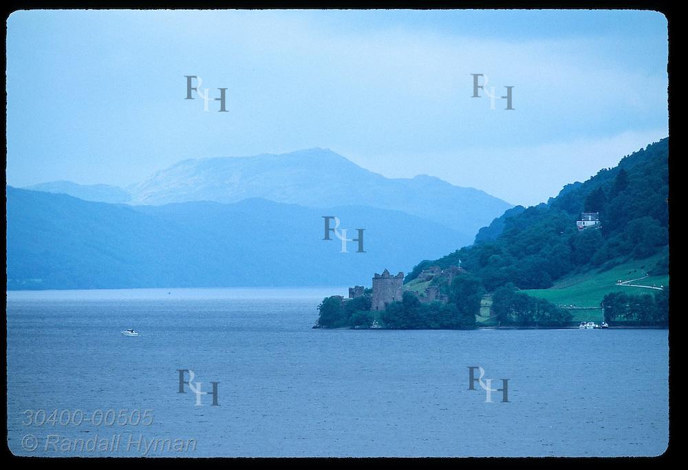 Motorboat plies the waters of Loch Ness near Urquhart Castle on a stormy July morn; Drumnadrochit. Scotland