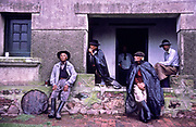 """Portrait of Gauchos at day break as they prepare to sadle up and go into the open """"Pampa"""" grasslands to heard cattle, Vichadero, Uruguay"""