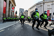"Territorial Support Group unit rush towards a group of protestors who formed a line of resistance in Trafalgar Square during a ""Resist and Act for Freedom"" protest against a mandatory coronavirus vaccine, wearing masks, social distancing and a second lockdown, nearby Canada House in Trafalgar Square, London on Saturday, Sept. 19, 2020. The event, which began at noon, drew a broad coalition including coronavirus sceptics, 5G conspiracy theorists and so-called ""anti-vaxxers"". Speakers at the event accused the government of attempting to curtail civil liberties. (VXP Photo/ Vudi Xhymshiti)"