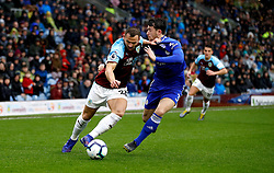 Burnley's Phillip Bardsley (left) and Leicester City's Ben Chilwell (right) battle for the ball during the Premier League match at Turf Moor, Burnley.