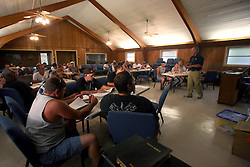 07 June 2010. Pointe aux Chenes, Louisiana.<br /> Fading away. Fisherman and local Pointe Aux Chenes Indians take a 40 hour Hazardous waste operation class in order to get certification to work for BP as sub contractors cleaning up oil. The isolated town of Pointe Aux Chenes clings to the little land that remains along the bayous and waterways of southern Louisiana. Oil washes up on the  marsh grasses just south of tribal homes. If the grass dies, there is nothing left to hold the land. All of this was solid ground just 100 years ago. Diversion of the mighty Mississippi River diverted sediment from the wetlands and deposited precious land building material deep out at sea.  At present, all these fishing grounds are closed. Members of the Pointe Aux Chenes Indians, settlers that can trace their roots beyond 5 generations back to France face extinction of their very way of life, their very existence. French cajun is the language of the elders, but is dying out in the children of today. BP's catastrophic oil spill threatens everything, their way of life and the land on which they live. Not recognised by the federal government, the 680 member tribe struggles for funds in a small community that survives only because of fishing and oil extraction in the Gulf of Mexico.<br /> Photo; Charlie Varley/varleypix.com