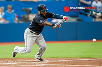 Aug 31, 2015; Toronto, Ontario, CAN; Cleveland Indians Abraham Almonte (35) bunts for a single against Toronto Blue Jays in the third inning at Rogers Centre. Mandatory Credit: Peter Llewellyn-USA TODAY Sports