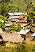 14 MARCH 2013 - BAN PANG SAI, LAOS: The village of Ban Pang Sai in Luang Namtha is a traditional rural Lao community with wooden homes raised off the ground. Traditional thatch roofing is being replaced by metal though. PHOTO BY JACK KURTZ