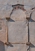 remains of an arch that was plastered over during an inapt renovation Photographed in Jaffa, Israel