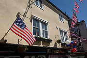 US and British flags and balloons outside the Prince Harry pub in the old town of Windsor as it gets ready for the royal wedding between Prince Harry and his American fiance Meghan Markle, on 14th May 2018, in London, England.