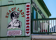 Shady Lady Restaurant's building was constructed in 1888, in Silverton, Colorado, USA. Madam Jew Fanny closed this shop in 1947, the last brothel in Silverton. Silverton is a former silver mining camp, now the federally-designated Silverton Historic District. Durango is linked to Silverton by the Durango and Silverton Narrow Gauge Railroad, a National Historic Landmark. Silverton no longer has active mining, but subsists on tourism, maintenance of US 550 (which links Montrose with Durango), mine pollution remediation, and retirees.