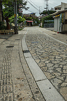Naha Tsuboya Pottery Village streets are made with limestone cobblestones. Most of the treasures, hidden cafes and workshops are found on the side alleys that branch off of the main road. .  Tsuboya feelsl as though one has been transported to a small village instead of in the middle of a concrete and urban city.  Naha Tsuboya district has been a center for Okinawan pottery since the heyday of the Ryukyu Kingdom.