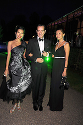 Left to right, GOGA ASHKENAZI, ROBERT HANSON and MERUERT BERKALIEVA at the Royal Parks Foundation Summer Party hosted by Candy & Candy on the banks of the Serpentine, Hyde Park, London on 10th September 2008.