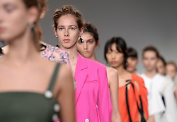 Model on the catwalk during the Eudon Choi London Fashion Week SS18 show held at the BFC Show Space, London.