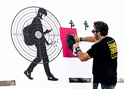May 05, 2018 - Dallas, Texas, U.S. -  Artist MANUEL OLIVER, father of a Parkland, Florida shooting victim, creates a multi-media mural at one of several protests taking place during the NRA's annual convention.(Credit Image: © Brian Cahn via ZUMA Wire)