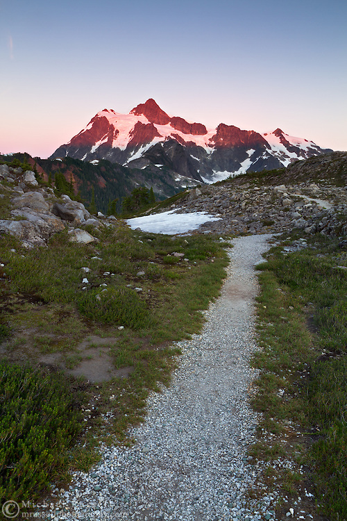 A trail heads toward Mount Shuksan and Huntoon Point at the Mount Baker-Snoqualmie National Forest in Washington State, USA