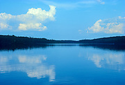 Cloud reflection in Siderock Lake, Nopiming  Provincial Park, Manitoba, Canada