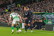 James Forrest of Celtic FC stands his ground as Pierre Bengtsson of FC Copenhagen looks for a pass during the Europa League match between Celtic and FC Copenhagen at Celtic Park, Glasgow, Scotland on 27 February 2020.