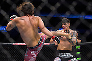 DALLAS, TX - MARCH 14:  Elias Theodorou kicks Roger Narvaez during UFC 185 at the American Airlines Center on March 14, 2015 in Dallas, Texas. (Photo by Cooper Neill/Zuffa LLC/Zuffa LLC via Getty Images) *** Local Caption *** Elias Theodorou