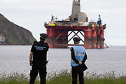 Greenpeace activists board a BP oil rig in Cromarty Firth to stop it from further oil drilling at sea, June 10th 2019, Cromarty, Scotland, United Kingdom. The oil rig Paul B. Loyd, Jnr, owned by Transocean, was due to head to BPs Vorlich field, 150 miles 241km east of Aberdeen to drill for oil for BP. Police monitoring the the occupied oil rig. The occupation by Greenpeace activists subsequently delayed the departure for 5 days and 14 activists were arrested in the process. Greenpeace says that in an age of climate emergency BP should not be drilling for new oil but look for non-fossil fuel means of energy.