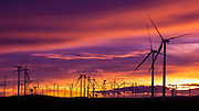 Silhouetted wind turbines at sunset, Mojave, California