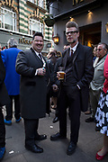 Teddy Boys gather outside a pub in Soho following a 40th anniversary of their infamous march on the BBC to protest that they wanted more rock and roll on the radio, which they recreated today on May 14th 2016 in London, United Kingdom. Teddy Boy, also known as Ted, is a British subculture typified by men wearing clothes that were partly inspired by the styles worn by dandies in the Edwardian period, which tailors had attempted to re-introduce in Britain after World War II. It is sometimes inaccurately written that the Teddy Boy style and phenomenon appeared in Britain during the mid 1950s as a rebellious side effect to the introduction of American RocknRoll music. The Teddy Boy predates this and was a uniquely British phenomenon. The subculture started in London in the early 1950s, and rapidly spread across the UK, then becoming strongly associated with rock and roll. Originally known as Cosh Boys, the name Teddy Boy was coined when a 1953 Daily Express newspaper headline shortened Edwardian to Teddy. The fashion featured tapered trousers, long jackets, fancy waist coats and their hair styled into a quiff.