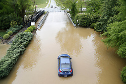 April 25, 2017 - Raleigh, North Carolina, U.S.- One vehicle lies stranded by the bridge leading into the back side of Crabtree Valley Mall on Tuesday, amid heavy rain in the area. (Credit Image: © Chris Seward/TNS via ZUMA Wire)
